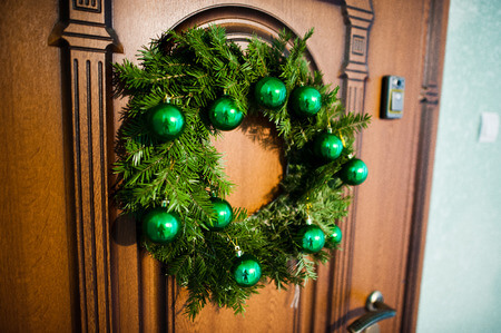 50625796 - christmas wreath on brown wooden door